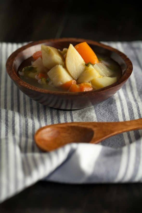 French Vegetable Soup in wood bowl with spoon