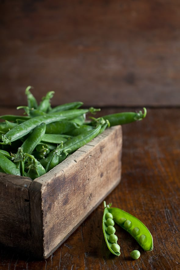 fresh peas in wooden box by Ilva Beretta