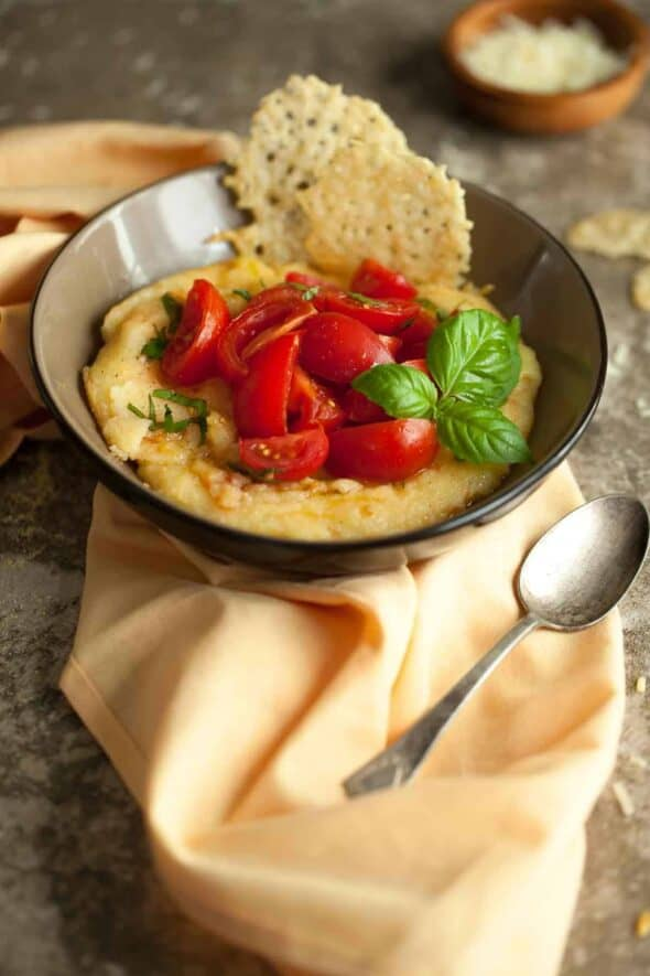 Easy Polenta with Fresh Tomatoes and Parmesan Crisps in Bowl on Napkin