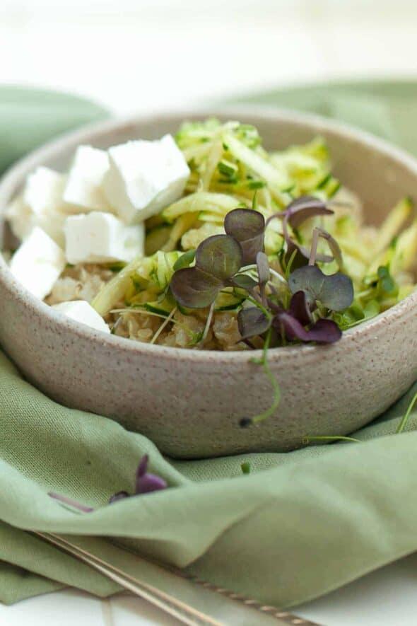 Zucchini Quinoa Salad with Microgreens in Ceramic Bowl