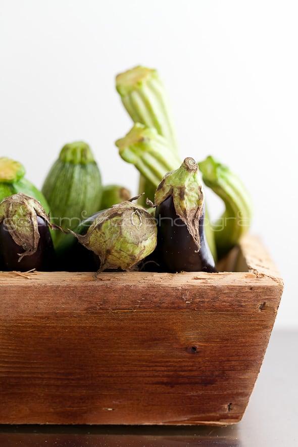 eggplant and zucchini in wood box
