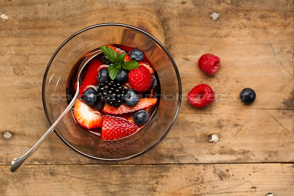 two cups of mixed fresh berries macerated in a rosé wine with honey mascarpone (fruit soup) in cup
