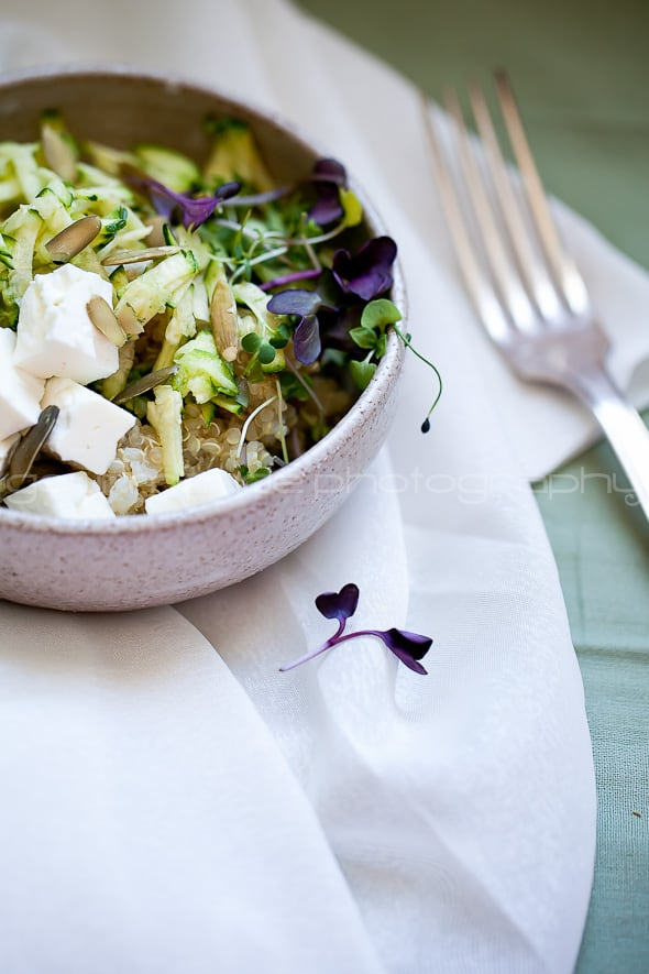 zucchini, quinoa, microgreens salad with fork