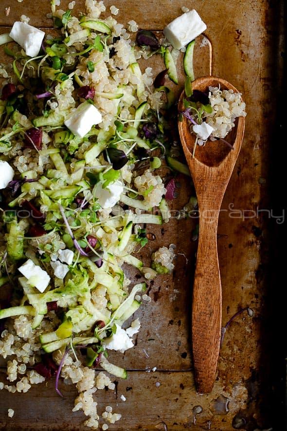 zucchini, quinoa, microgreens salad with spoon
