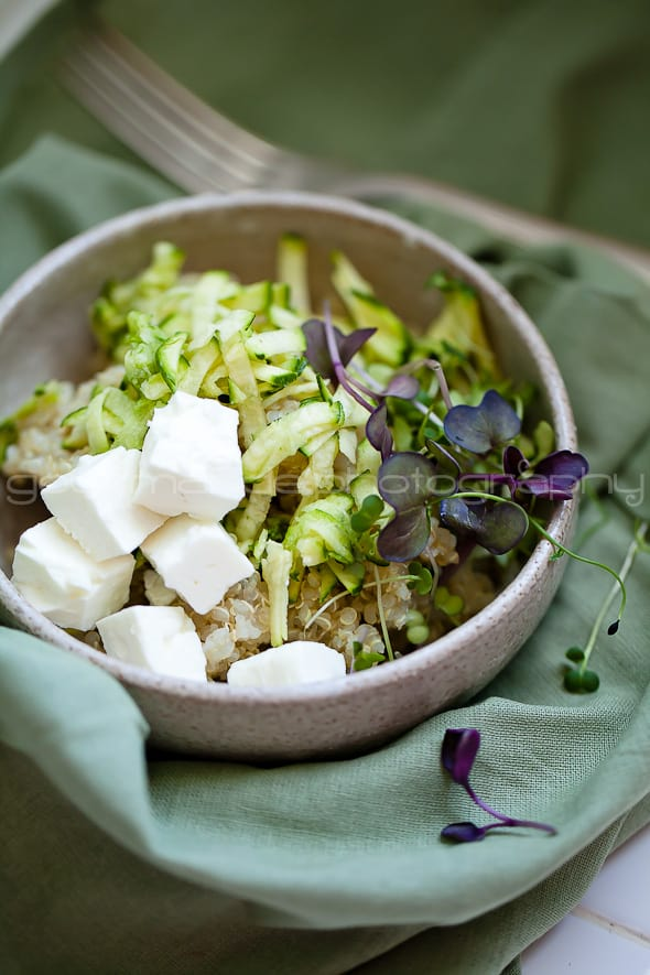 zucchini, quinoa, microgreens salad in bowl