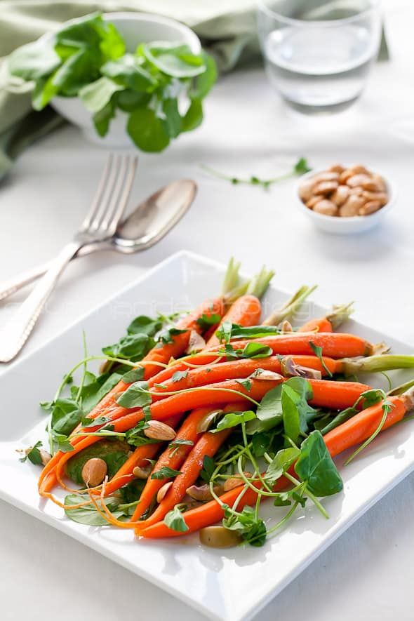carrot watercress salad on table