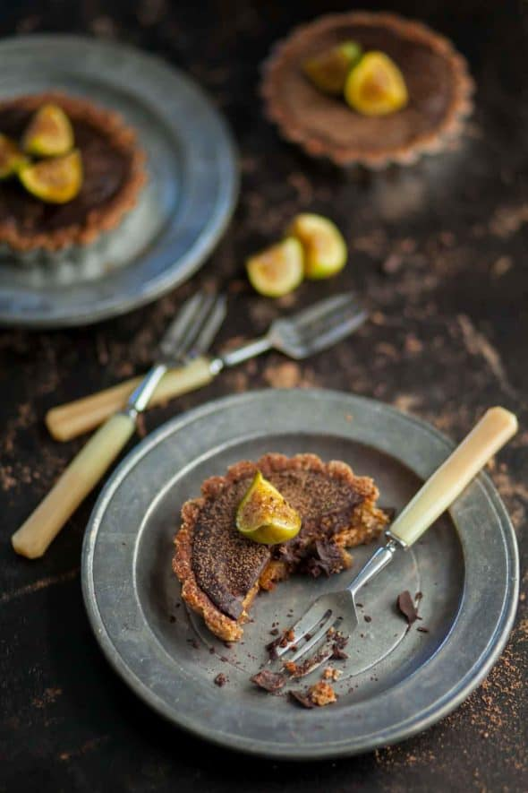 Chocolate Fig Tarts on plates with forks