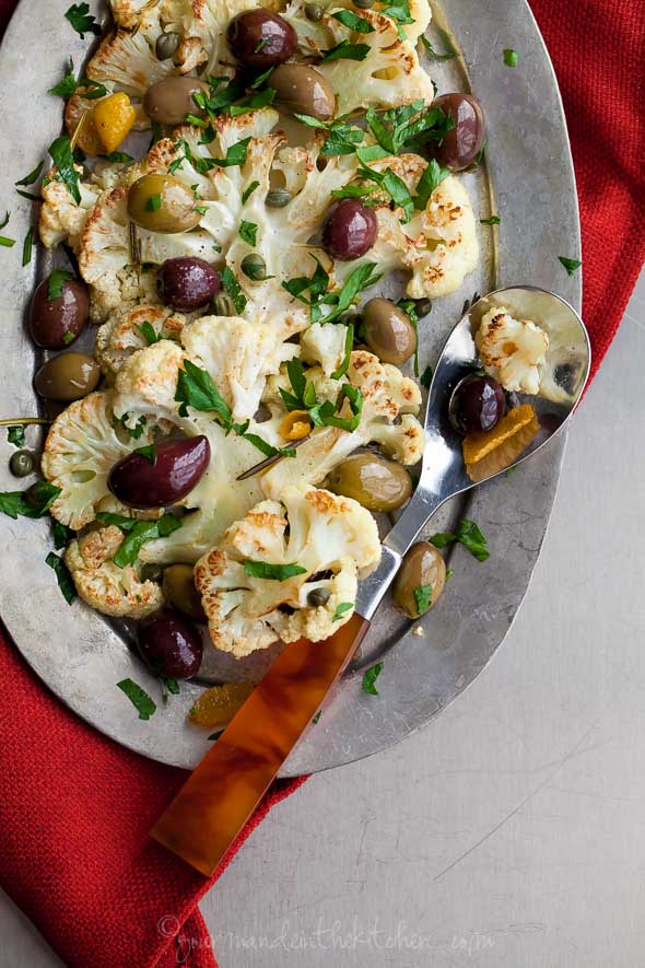 Roasted Cauliflower with Olives and Herbs on Plate with Serving Spoon