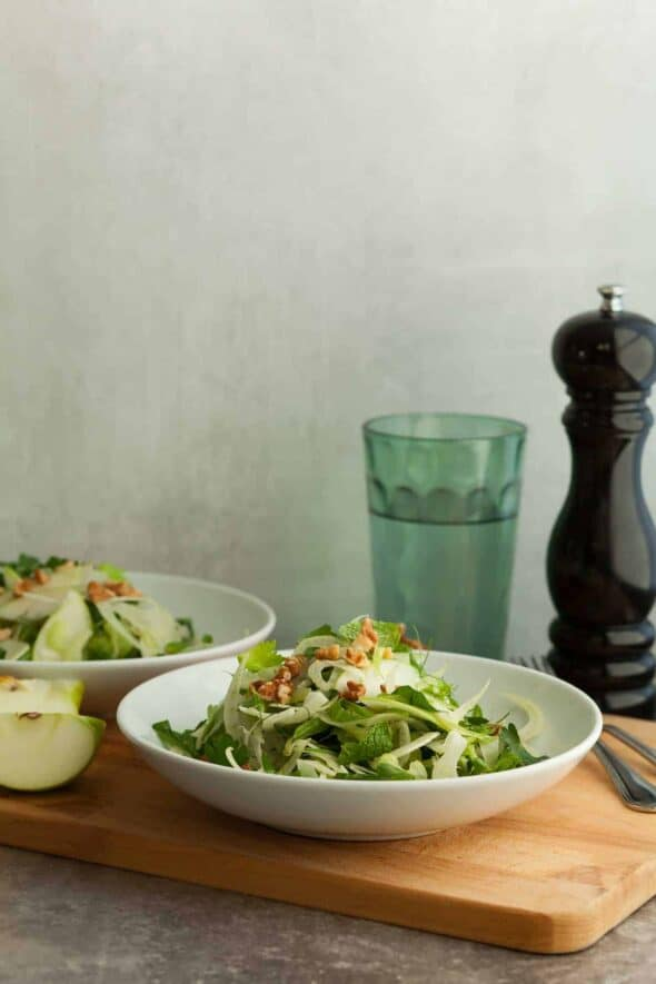 Apple Fennel Celery Salad in Two White Bowls