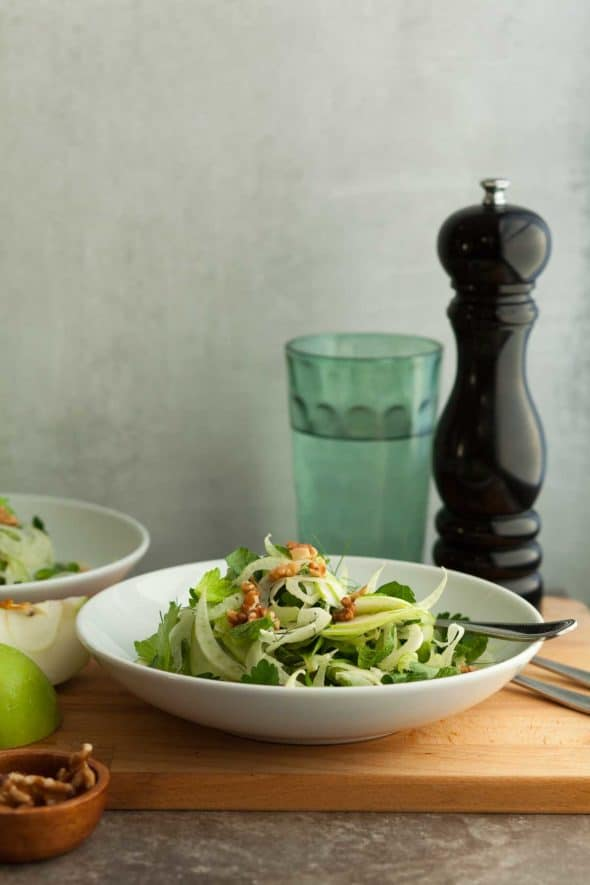 Apple Fennel Celery Salad in Bowl with Fork on Wood Board