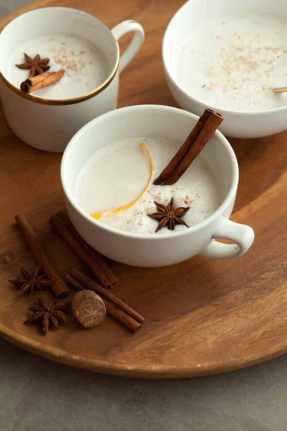 Vegan Warm Spiced Cashew Coconut Milk in Mugs on Wood Serving Tray