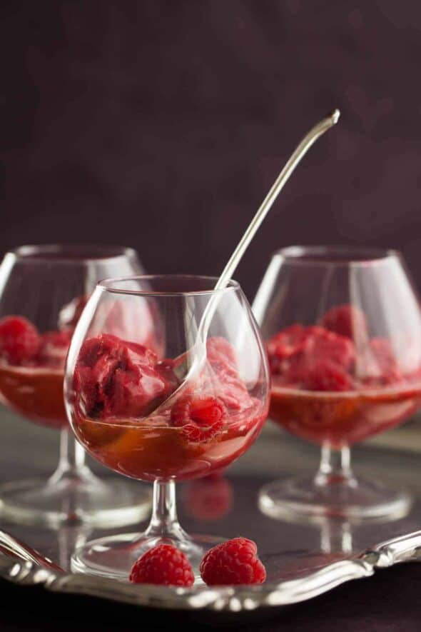 This float is all grown up, raspberry lychee sorbet is served in coktail glasses with champagne poured over for a festive dessert that doubles a cocktail.