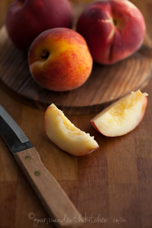Peaches on cutting board