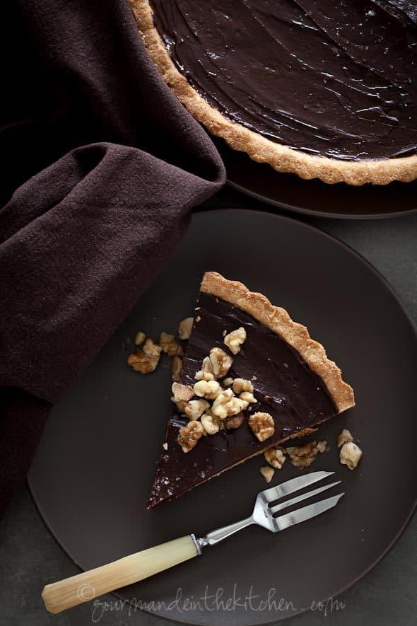 Chocolate Date Caramel Walnut Tart Slice on Plate with Fork