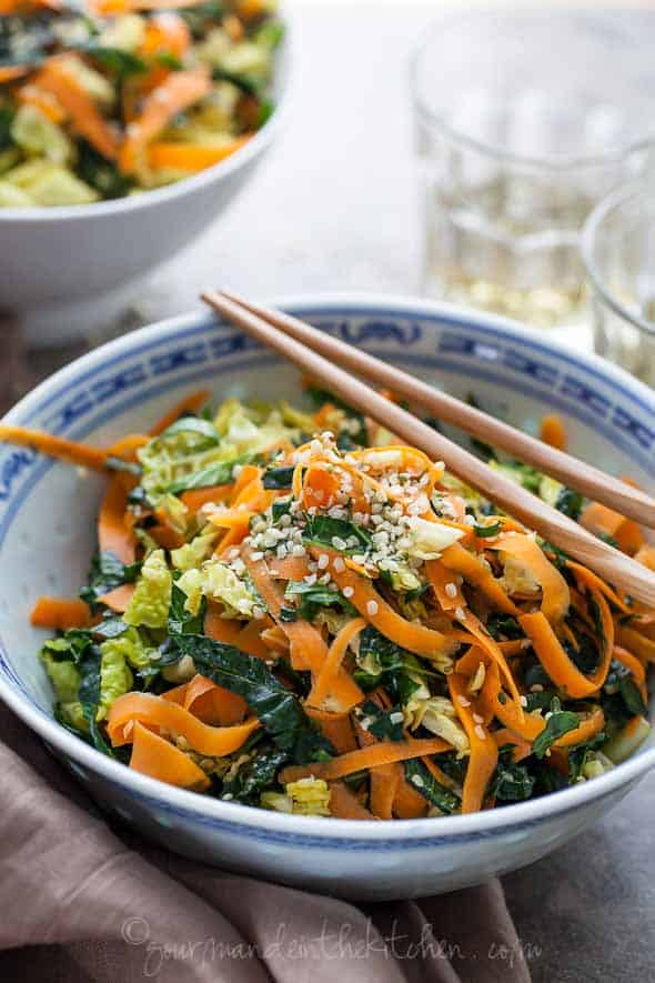 Kale, Cabbage and Carrot Chopped Salad with Maple Sesame Vinaigrette with chopsticks