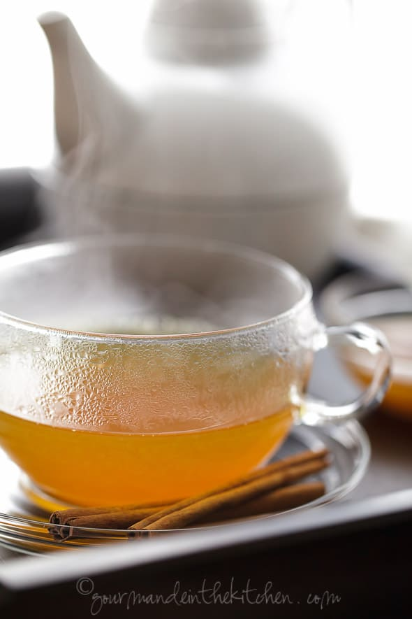 Spiced Persimmon, Ginger, Cinnamon, Turmeric Tea in Glass Mug on Tray