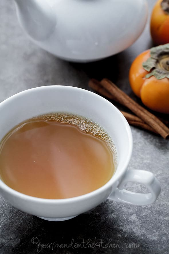 Spiced Persimmon, Ginger, Cinnamon, Turmeric Tea in Cup Side View