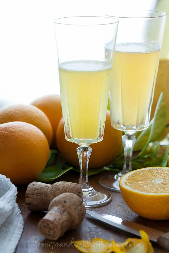 Mimosa Champagne Cocktail from gourmandeinthekitchen.com  Grand Mimosa Recipe | A Sparkling Toast to the New Year