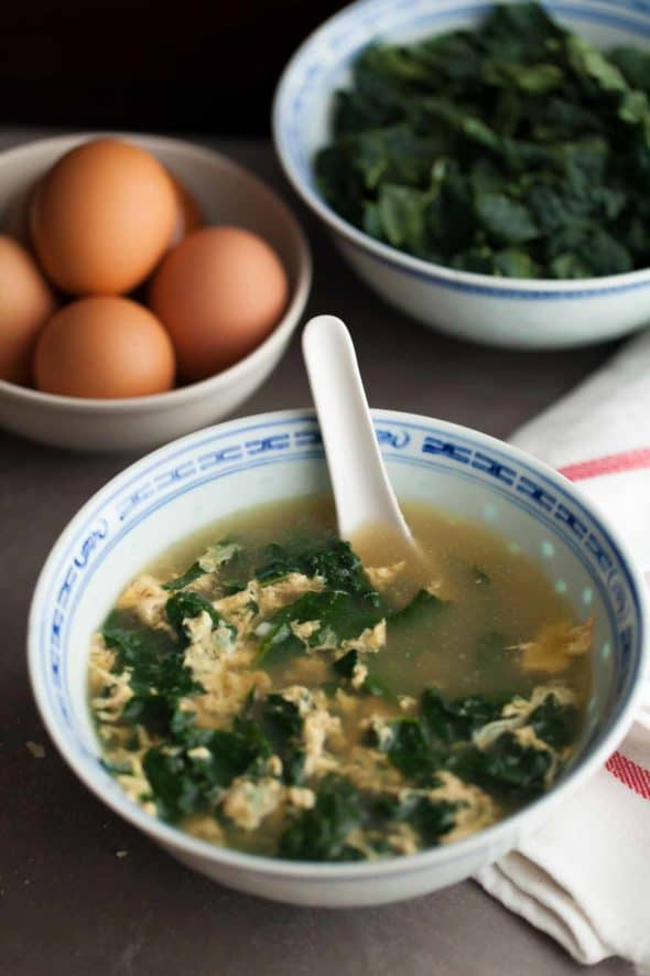 Winter Greens Italian Egg Drop Soup (Stracciatella) on Table with Spoon