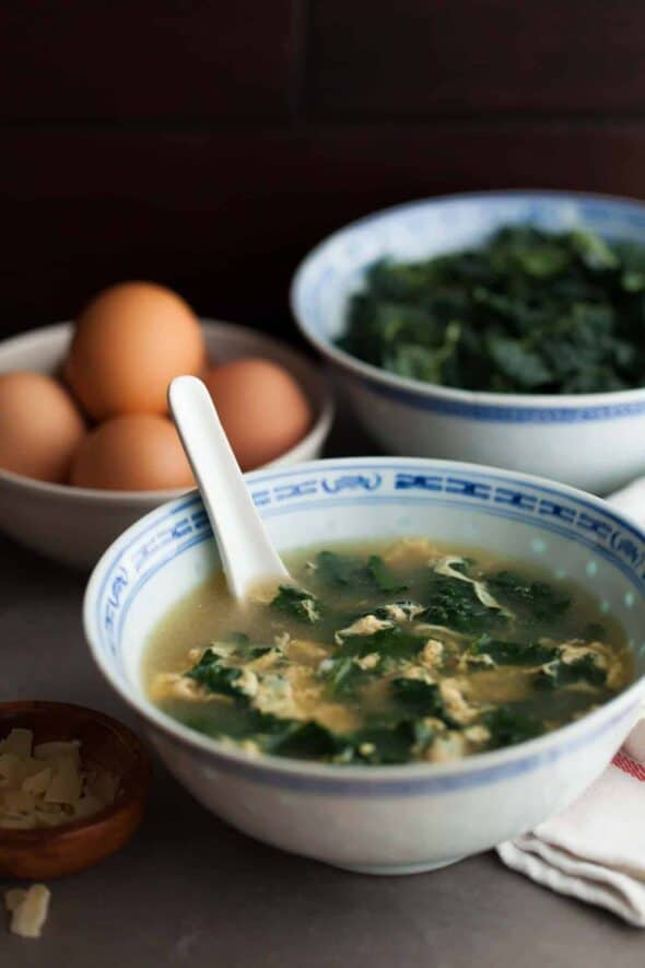 Italian Winter Greens Egg Drop Soup in Large Bowl with Spoon