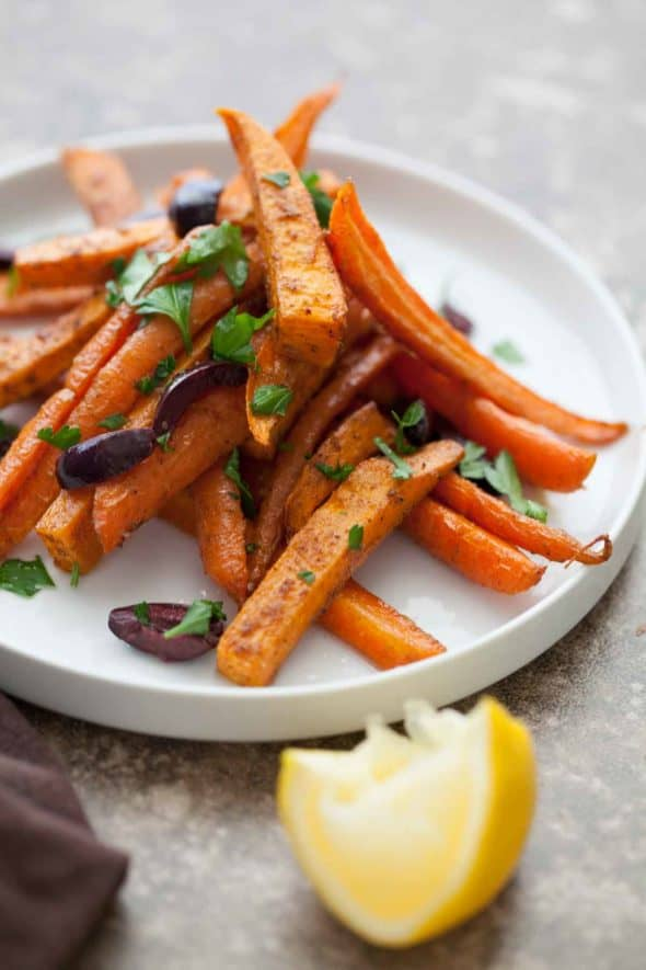 "Sweet potatoes and carrots are cut thinly into ""fries"" and tossed in a mixture of coconut oil kicked up with Moroccan spices like cumin, coriander and garlic."