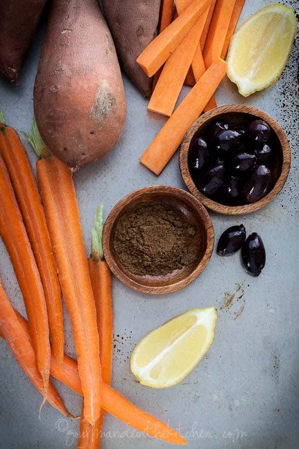 raw carrots, sweet potatoes, olives, cumin, lemon, ingredients, food photography