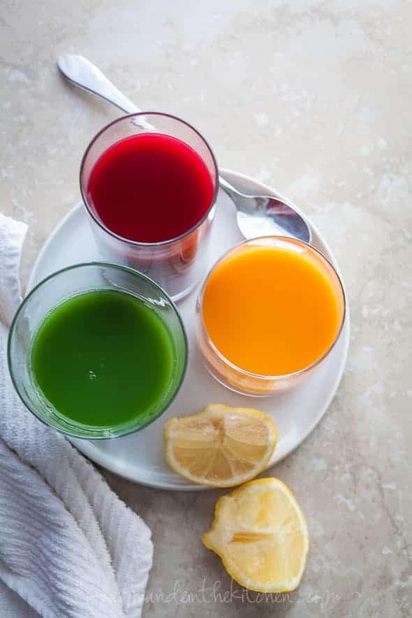 beet juice, carrot juice, green juice top view