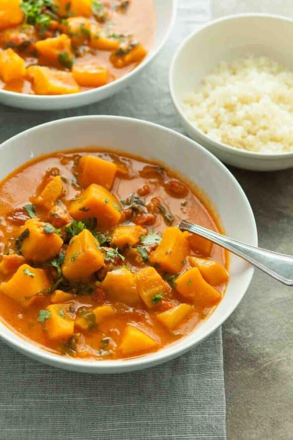 Butternut Squash Curry in Bowls Next to Cauliflower Rice