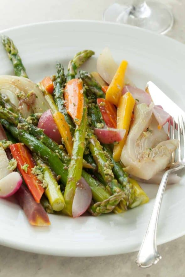 Braised Springtime Vegetables on White Plate