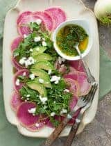 Carpaccio of Watermelon Radishes with Arugula and Citrus Avocado Dressing