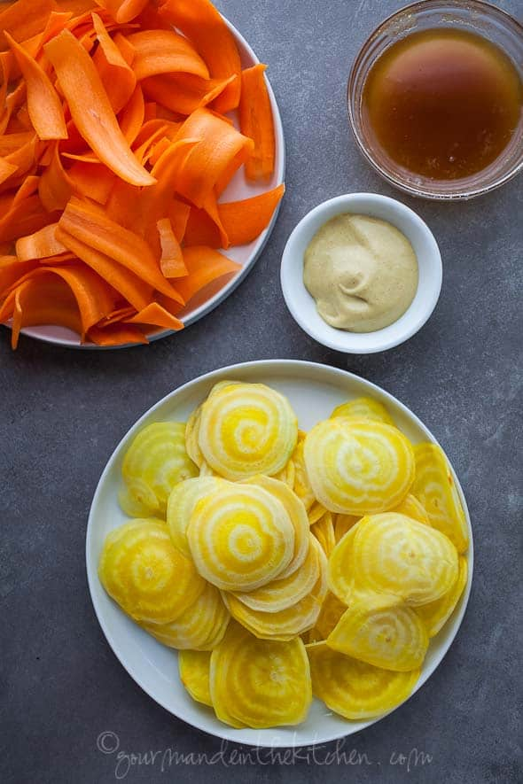 shaved carrots, shaved beets, mustard, dressing, vinaigrette