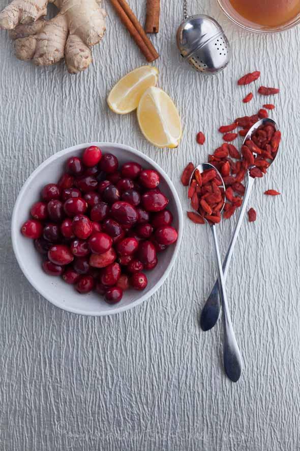 cranberries, goji berries, lemons, ginger, tea