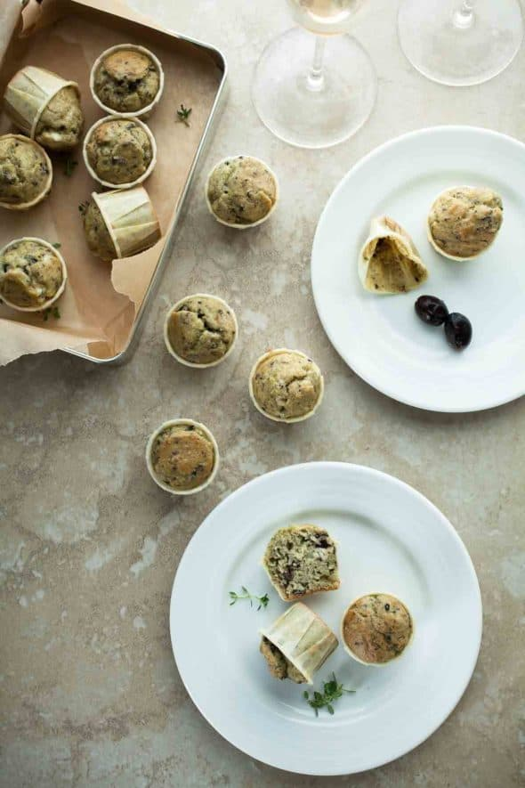 Savory grain-free miniature muffins studded with bits of chopped black olives, fresh thyme and salty feta cheese.