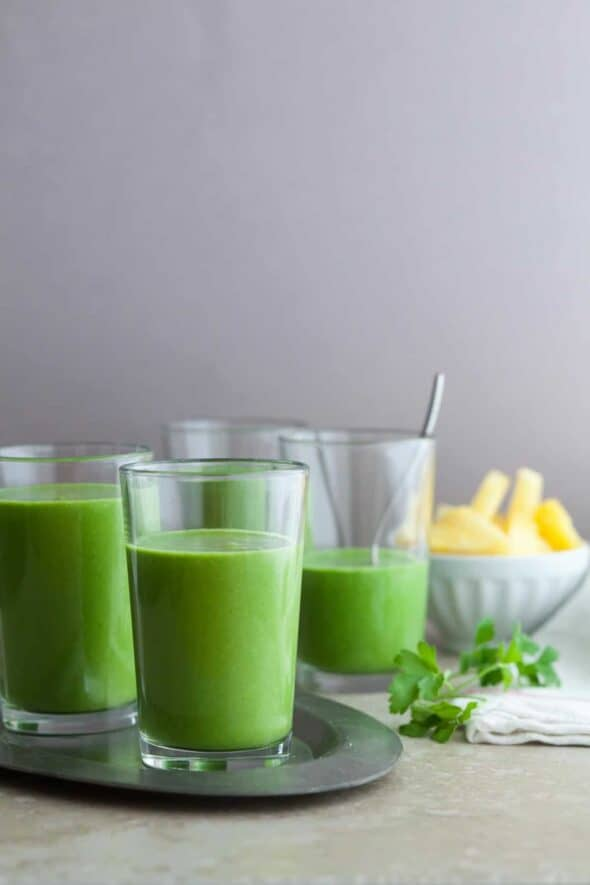 DRINK YOUR GREENS SMOOTHIE  A green smoothie packed with nutrients featuring a trio of greens along with pineapple and coconut milk.