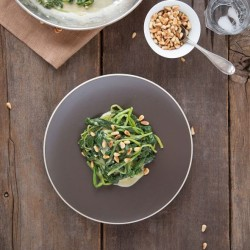 Dijon Spinach with Toasted Pine Nuts from the Slim Palate Cookbook