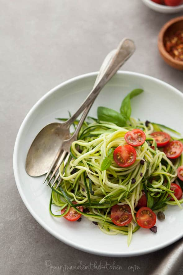 zucchini noodles, zucchini pasta, paleo noodles, vegan zucchini noodles, raw zucchini noodles, caper olive sauce, pasta puttenesca