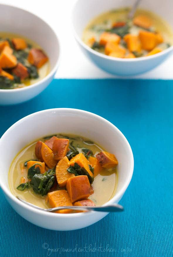 Thai-Style Coconut, Sweet Potato and Spinach Soup in Bowls on Blue Tablecloth