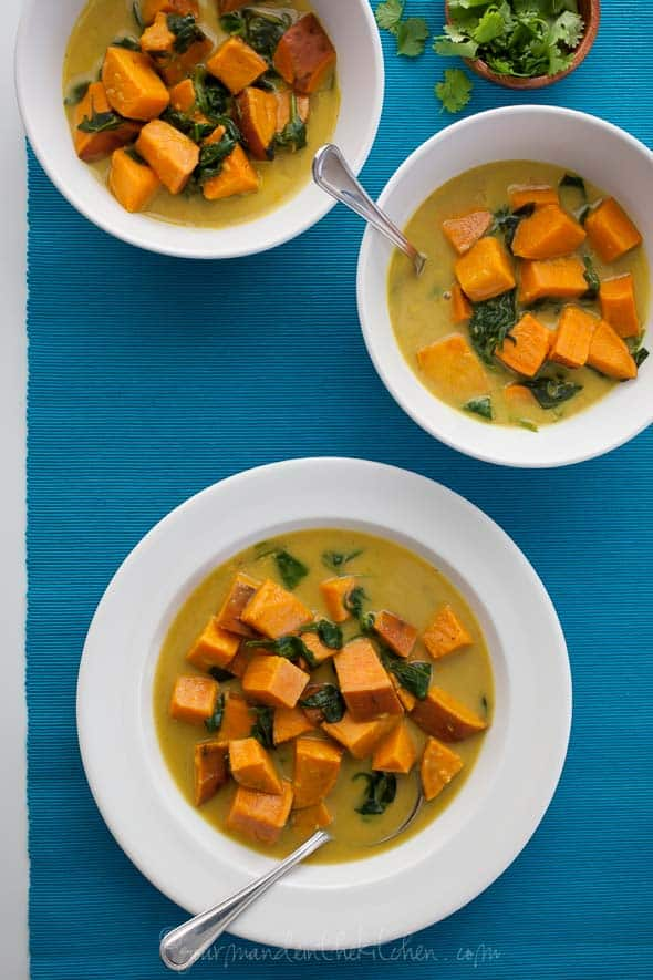 Thai-Style Coconut, Sweet Potato and Spinach Soup in White Bowls