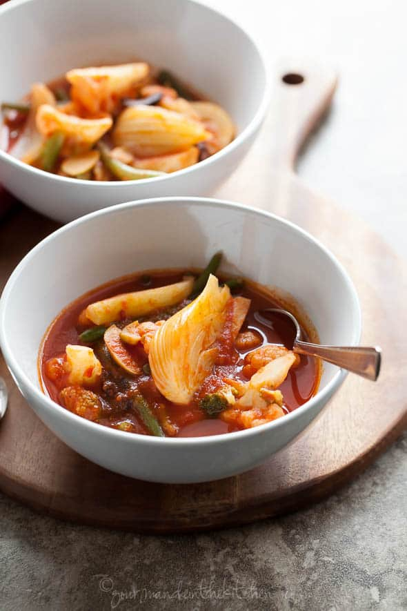 Quick Spicy Tomato Vegetable Soup in Bowl with Spoon