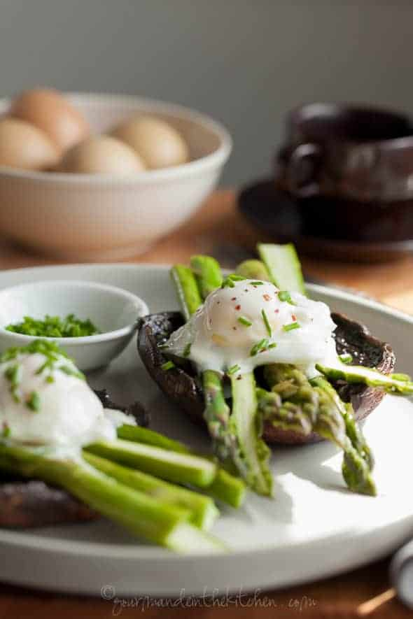 Portobello Mushroom Eggs Benedict with Asparagus on with Goat Cheese Sauce on Plate