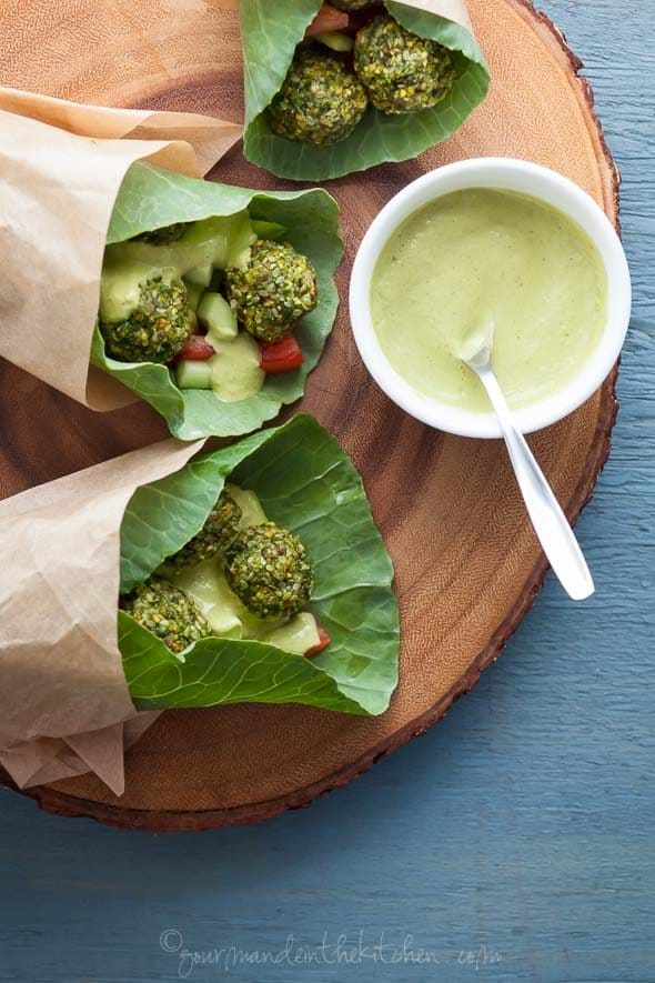 Raw Falafel Wraps with Parsley Tahini Sauce with Sauce on Board