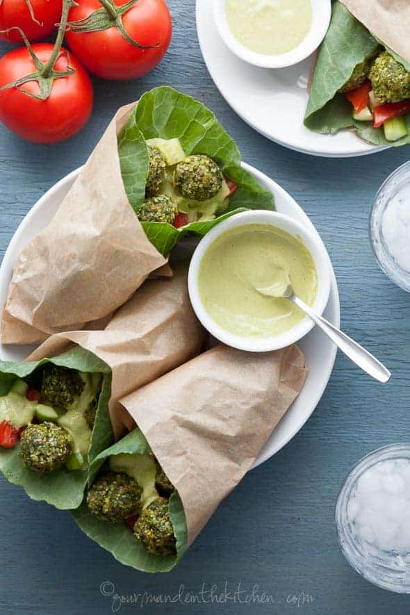 Raw Paleo Falafel Wraps with Parsley Tahini Sauce on Plate with Sauce