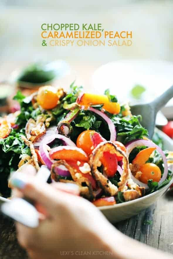 Kale, Caramelized Peach & Crispy Onion Salad in Bowl with Serving Spoons