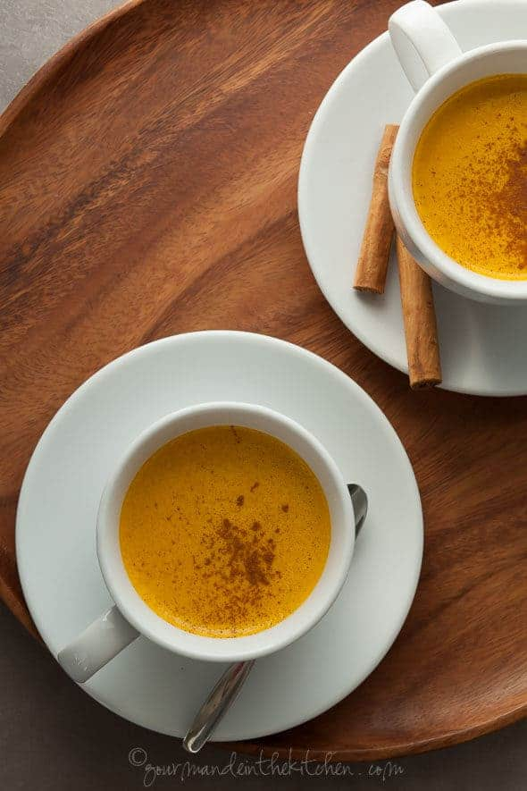 Spiced Sweet Potato Turmeric Milk in Cups on Wood Tray