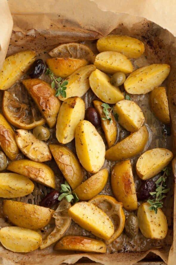 Greek Style Lemon Potatoes on Parchment in Pan