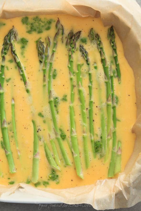 An oven baked omelette topped with asparagus and pesto, makes for an easy make-ahead brunch or breakfast.