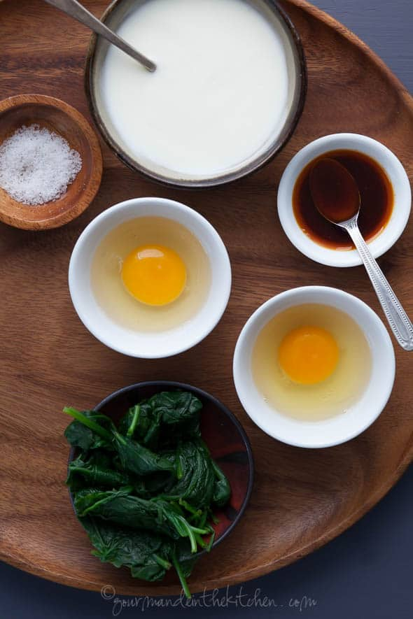 Creamy yogurt is topped with quickly poached eggs, spinach and spicy paprika oil for a satisfying breakfast.