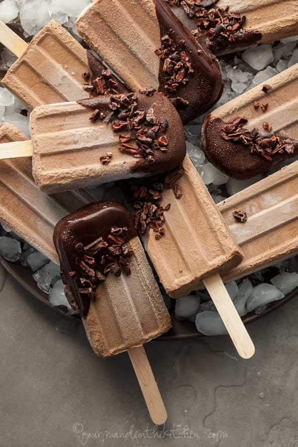 These no-cook vegan and paleo chocolate dipped fudge popsicles are a healthy twist on the classic summertime frozen treat.