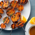 Miso-orange glazed grilled sweet potatoes cook up tender and creamy on the insides and are so much more fun than your standard baked potato on the grill.