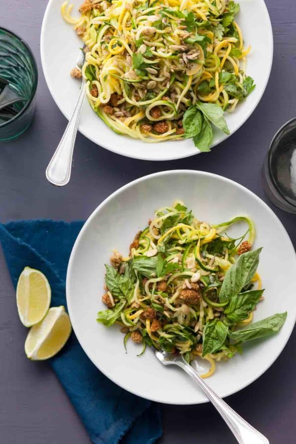 Spiralized Summer Squash Noodles with Basil Lime Dressing on Plates with Lime Wedges